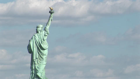The Statue of Liberty against a cloudy sky Stock Video Footage