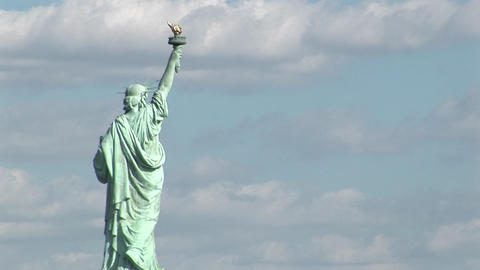 The Statue Of Liberty Against A Cloudy Sky stock footage