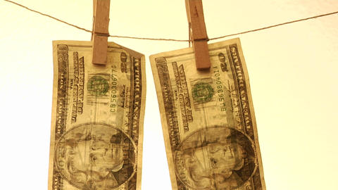 20 dollar bills hang from a clothesline clipped with... Stock Video Footage