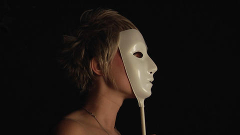 A woman with a heart painted on her cheek holds a white... Stock Video Footage