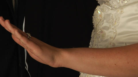 The Groom slips a ring on the bride's finger Stock Video Footage