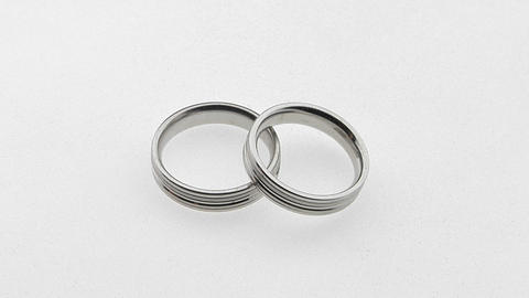 silver wedding rings overlap each other Stock Video Footage