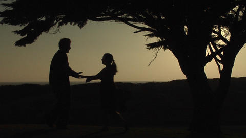 A couple dances together outside Stock Video Footage