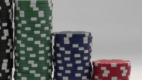Stacks of poker chips sit in a row, arranged by value Stock Video Footage
