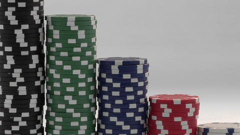 Stacks of poker chips sit in a row, arranged by value Footage