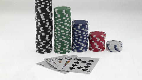 Stacks of poker chips sit in a row, arranged by value... Stock Video Footage