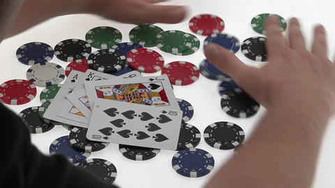 A poker player throws down his winning hand of cards then... Stock Video Footage
