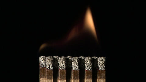 A book of matches ignite on fire Stock Video Footage
