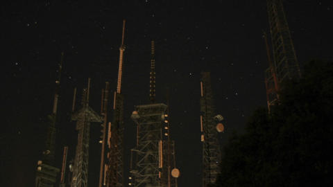 Worm's-eye view of multiple radio towers Stock Video Footage