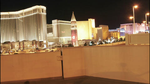 A car speeds through the streets of Las Vegas at night Stock Video Footage
