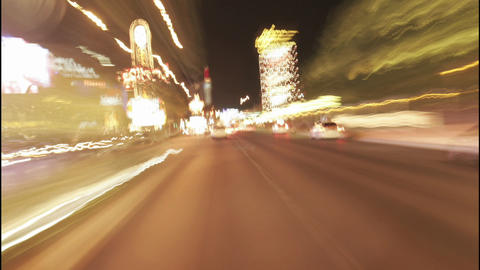 A car speeds through the streets of Las Vegas at night Footage