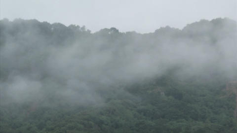 Fog rolls across a mountaintop Footage