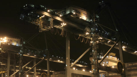 Workers construct a high-rise building at night Stock Video Footage