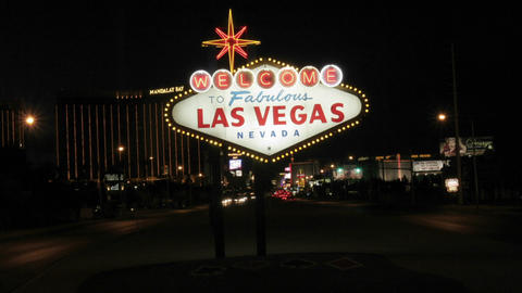 """The famous Welcome to Fabulous Las Vegas"""" sign lights up... Stock Video Footage"""