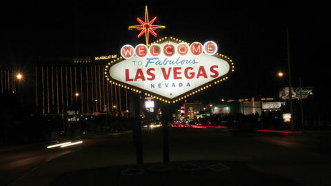 "The famous Welcome to Fabulous Las Vegas"" sign lights up the night sky Footage"