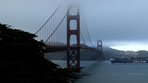 A cargo barge passes under the Golden Gate Bridge Stock Video Footage