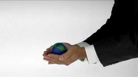 A pair of cupped hands hold a small globe Stock Video Footage