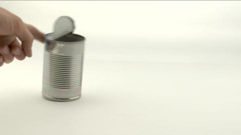 A hand knocks over an open tin can full of beans Stock Video Footage