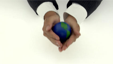 A pair of cupped hands holds a small globe Stock Video Footage