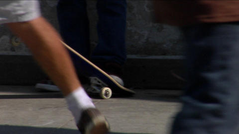 Several skateboarders skate around and flip their boards Stock Video Footage