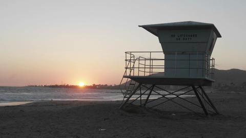 A lifeguard tower stands in sand on a beach Stock Video Footage
