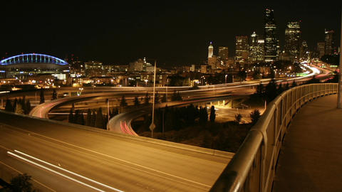 Traffic drives along a Seattle freeway at night Footage
