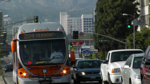 A metro bus moves through heavy traffic Stock Video Footage