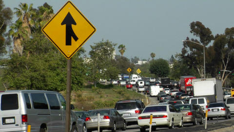 Heavy traffic moves along a three-lane highway Footage