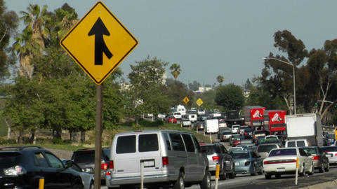 Heavy traffic moves along a three-lane highway Stock Video Footage