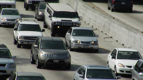 Heavy traffic moves slowly along a three-lane highway Stock Video Footage