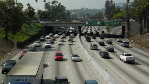 Traffic drives along a freeway Stock Video Footage