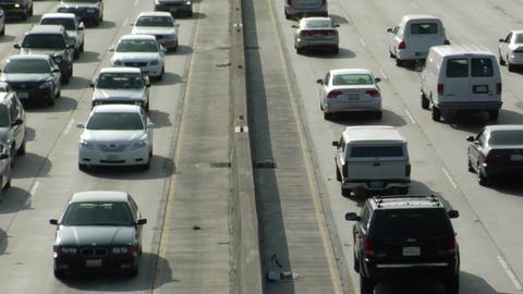 Traffic drives along a freeway Footage
