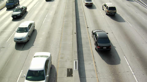 Traffic drives along a freeway Footage