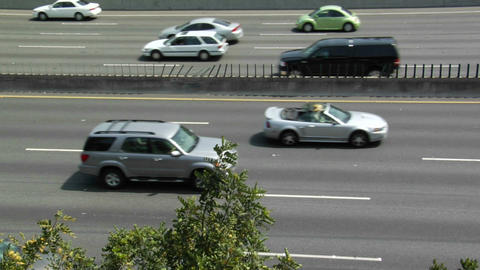 Traffic drives on a highway Stock Video Footage