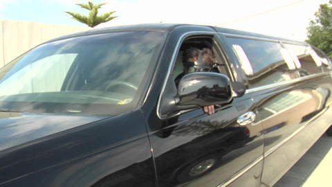 A man wearing a gas mask pulls forward in a limousine Stock Video Footage