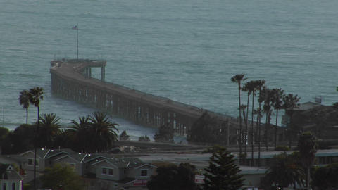 A pier curves out into the ocean Stock Video Footage