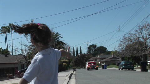 A girl hitchhikes on a residential street Stock Video Footage