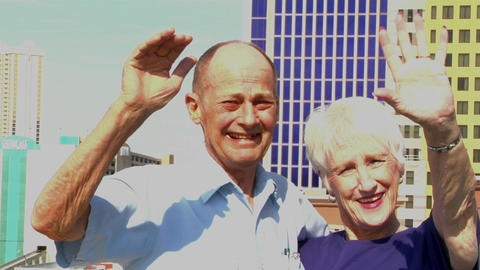 An elderly couple waves Footage