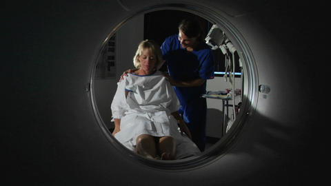 A patient lies down and waits for her medical test to begin Stock Video Footage