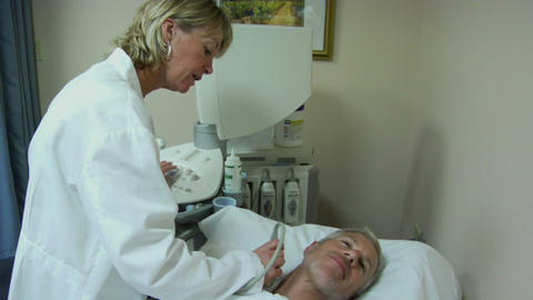 A technician uses an ultrasound machine on a patient Stock Video Footage