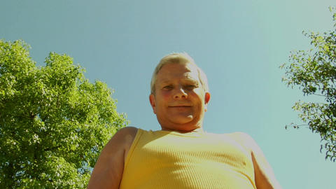 An older man flexes his muscles Stock Video Footage