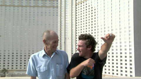 A man teaches his grandfather a dance Stock Video Footage