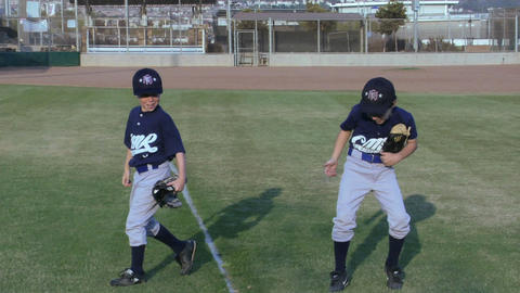 young baseball players give each other playful handshakes Stock Video Footage