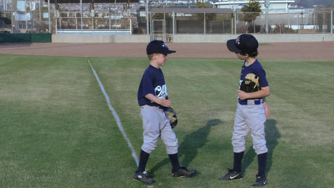 young baseball players give each other playful handshakes Footage
