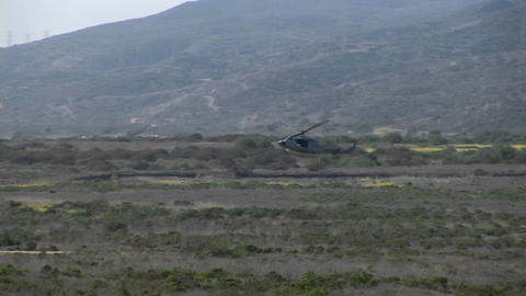 A helicopter lands on an Oceanside landing strip Footage