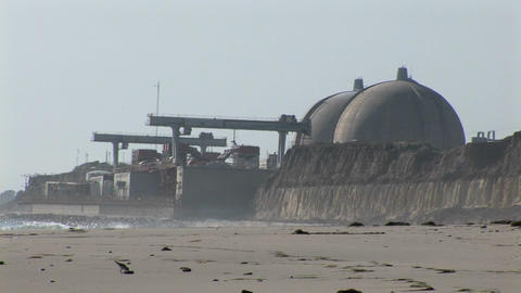 A power plant sits on the coast Stock Video Footage