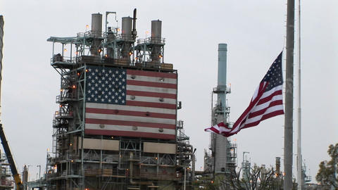 American flags hang at an industrial facility Stock Video Footage
