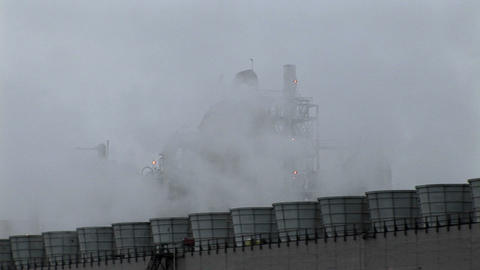 Smoke rises from stacks at a power facility Stock Video Footage