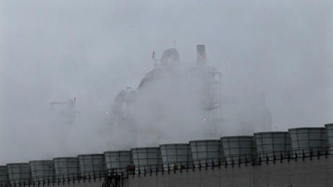 Smoke rises from stacks at a power facility Footage