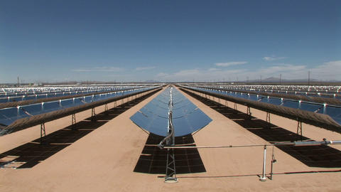 Banks of solar panels reflect in the hot sun Footage